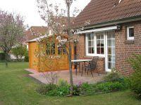 Terrasse mit Blockhütte